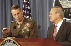 General Pace and Defense Secretary Donald Rumsfeld discussing the issue of prisoner abuse at a press conference, November 29, 2005. Photo by Tech Sgt. Sean P. Houlihan,  U.S. Air Force.