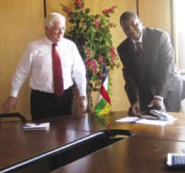 Faustin-Archange Touadera, Central African Republic Prime Minister, and Al Erisman wrap up a meeting.